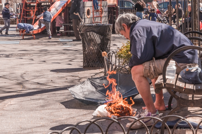 Man heating his feet, Chinatown 4/8/2017
